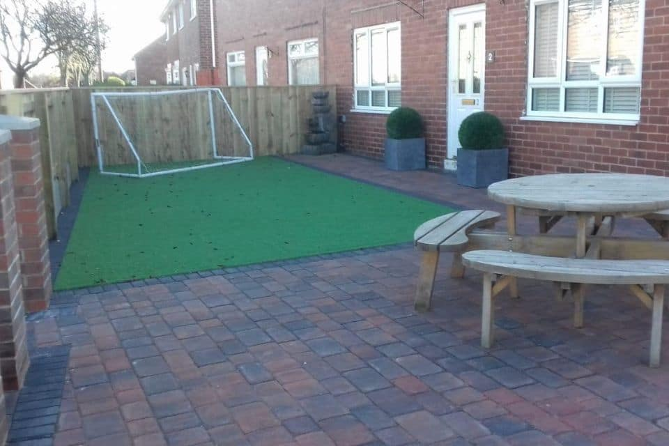 After-paving-artificial-lawn